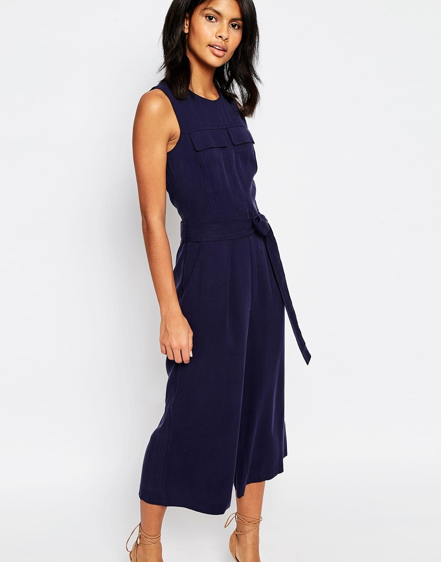 Tencel Jumpsuit Navy - pattern: plain; sleeve style: sleeveless; waist detail: belted waist/tie at waist/drawstring; predominant colour: navy; occasions: evening; length: calf length; fit: body skimming; fibres: viscose/rayon - 100%; neckline: crew; sleeve length: sleeveless; texture group: crepes; style: jumpsuit; pattern type: fabric; season: s/s 2016; wardrobe: event