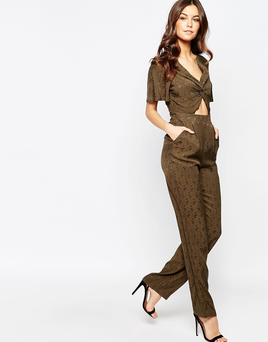 Khaki Cut Out Jumpsuit Khaki - length: standard; neckline: low v-neck; fit: tailored/fitted; bust detail: subtle bust detail; predominant colour: khaki; occasions: evening; fibres: polyester/polyamide - 100%; waist detail: cut out detail; sleeve length: short sleeve; sleeve style: standard; texture group: silky - light; style: jumpsuit; pattern type: fabric; pattern size: light/subtle; pattern: patterned/print; season: s/s 2016; wardrobe: event