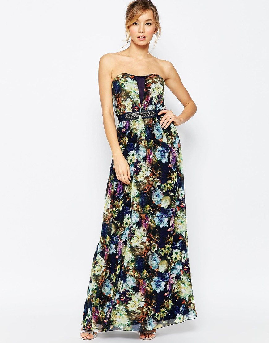 Maxi Dress With Belt In Floral Print Print - neckline: strapless (straight/sweetheart); style: maxi dress; sleeve style: strapless; predominant colour: navy; length: floor length; fit: fitted at waist & bust; fibres: polyester/polyamide - 100%; occasions: occasion; sleeve length: sleeveless; pattern type: fabric; pattern size: standard; pattern: florals; texture group: other - light to midweight; embellishment: embroidered; multicoloured: multicoloured; season: s/s 2016; wardrobe: event