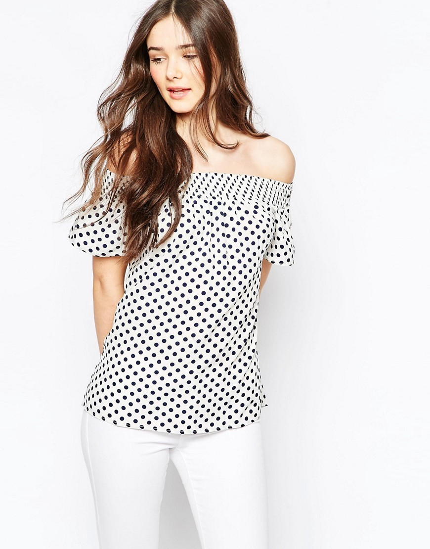 Polka Dot Off The Shoulder Top Blue - neckline: off the shoulder; pattern: polka dot; predominant colour: white; secondary colour: black; occasions: casual; length: standard; style: top; fibres: polyester/polyamide - 100%; fit: body skimming; sleeve length: short sleeve; sleeve style: standard; pattern type: fabric; texture group: other - light to midweight; multicoloured: multicoloured; season: s/s 2016; wardrobe: highlight