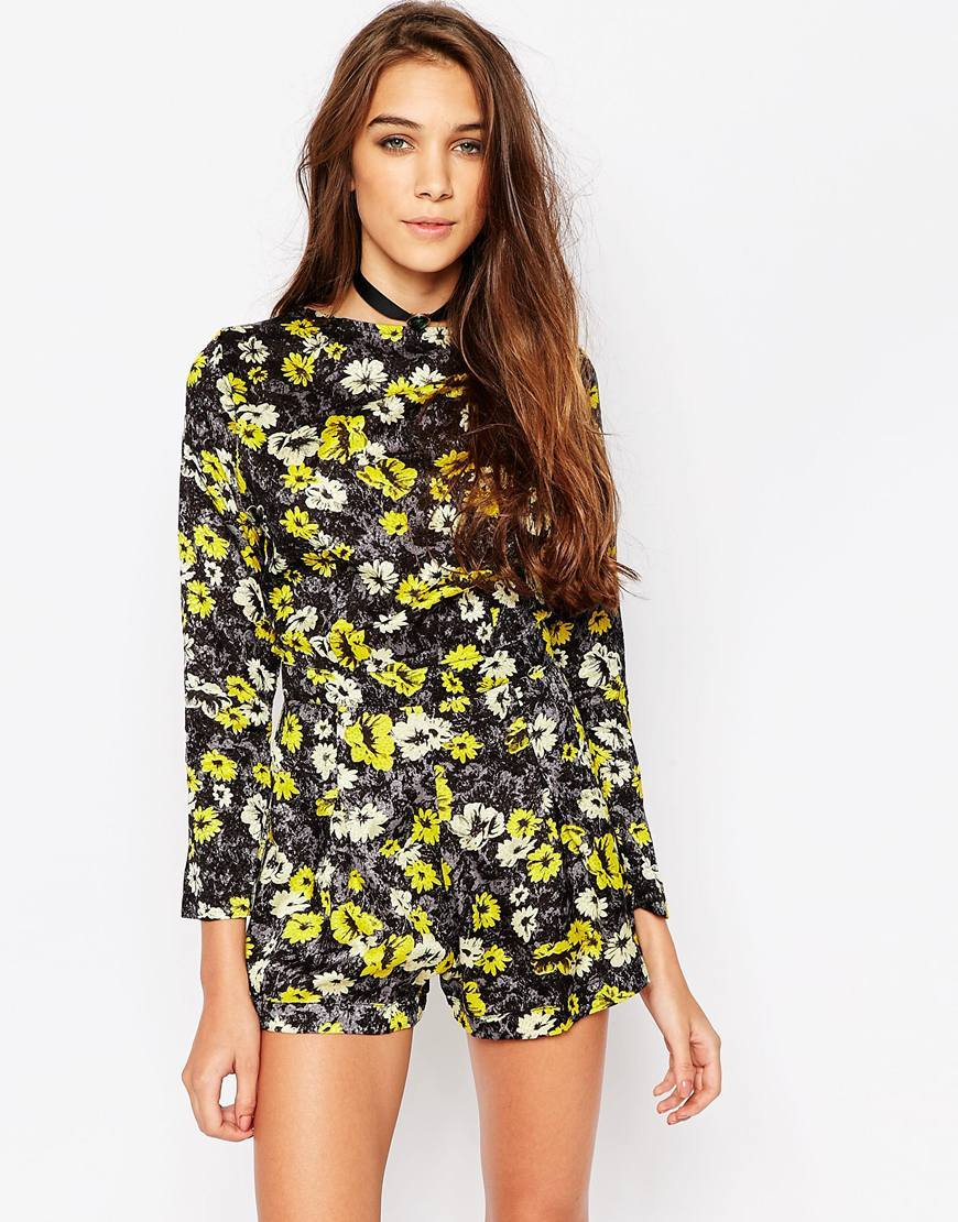 Molly Playsuit In Floral Print Aster Yellow - neckline: slash/boat neckline; waist detail: flattering waist detail; length: short shorts; secondary colour: yellow; predominant colour: black; occasions: evening; fit: body skimming; fibres: viscose/rayon - 100%; sleeve length: long sleeve; sleeve style: standard; style: playsuit; pattern type: fabric; pattern size: standard; pattern: florals; texture group: woven light midweight; multicoloured: multicoloured; season: s/s 2016; wardrobe: event