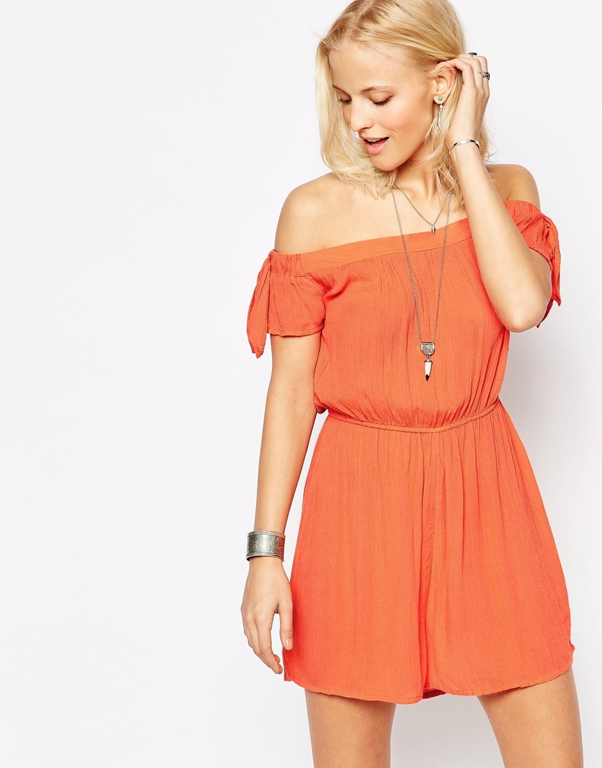 Tie Sleeve Bardot Playsuit Coral - neckline: off the shoulder; fit: fitted at waist; pattern: plain; length: short shorts; predominant colour: bright orange; occasions: casual; fibres: viscose/rayon - 100%; sleeve length: short sleeve; sleeve style: standard; style: playsuit; pattern type: fabric; texture group: other - light to midweight; season: s/s 2016; wardrobe: highlight