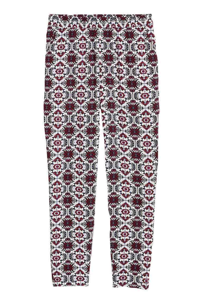 Trousers Loose Fit - length: standard; waist: mid/regular rise; secondary colour: white; predominant colour: burgundy; occasions: casual; fibres: viscose/rayon - 100%; fit: slim leg; pattern type: fabric; pattern: patterned/print; texture group: other - light to midweight; style: standard; pattern size: standard (bottom); season: s/s 2016; wardrobe: highlight