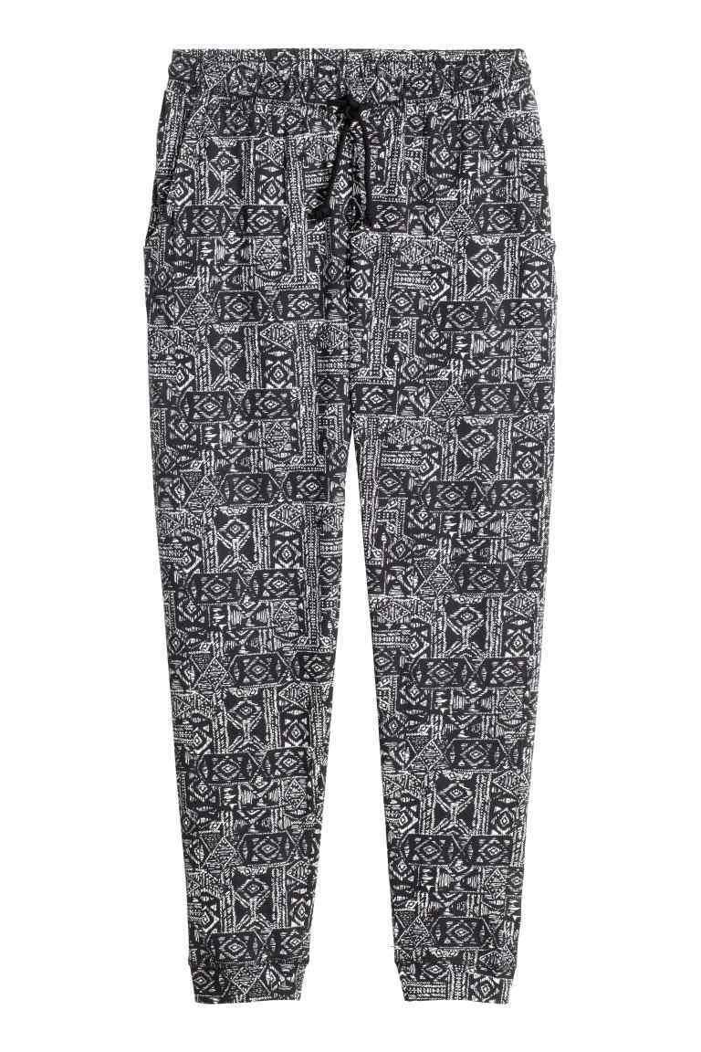 Joggers - style: tracksuit pants; waist detail: belted waist/tie at waist/drawstring; waist: mid/regular rise; secondary colour: white; predominant colour: mid grey; occasions: casual, creative work; length: ankle length; fibres: polyester/polyamide - 100%; trends: monochrome; fit: tapered; pattern type: fabric; pattern: patterned/print; texture group: other - light to midweight; pattern size: standard (bottom); season: s/s 2016; wardrobe: highlight