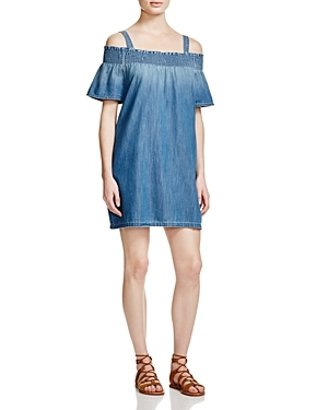 The Madeline Denim Dress - length: mid thigh; neckline: off the shoulder; pattern: plain; style: sundress; predominant colour: denim; occasions: casual; fit: body skimming; fibres: cotton - 100%; sleeve length: short sleeve; sleeve style: standard; texture group: denim; pattern type: fabric; season: s/s 2016; wardrobe: highlight