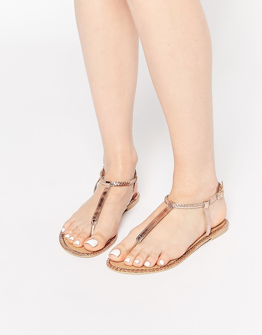 Feather Leather Plait Sandals Rose Gold - predominant colour: gold; occasions: casual, holiday; material: faux leather; heel height: flat; ankle detail: ankle strap; heel: standard; toe: open toe/peeptoe; style: strappy; finish: plain; pattern: plain; season: s/s 2016; wardrobe: basic