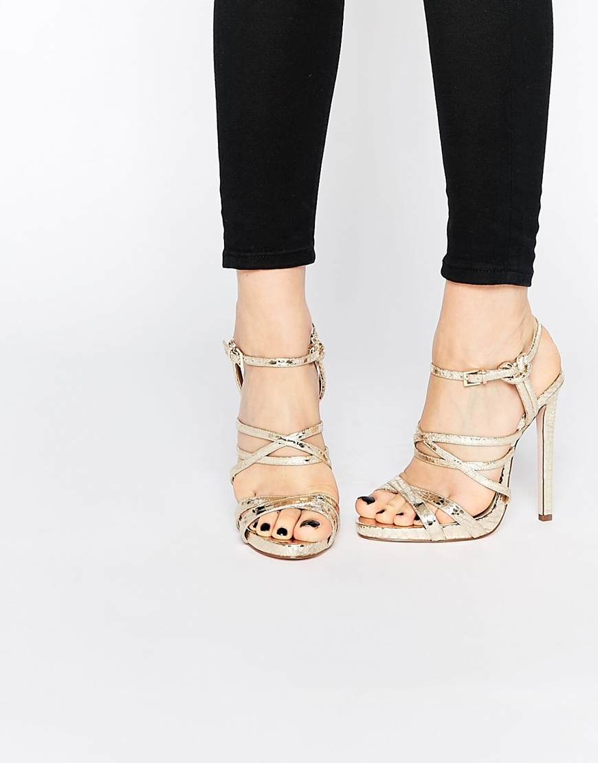 High Life Caged Heeled Sandal Gold - predominant colour: gold; occasions: evening, occasion; material: faux leather; ankle detail: ankle strap; heel: stiletto; toe: open toe/peeptoe; style: strappy; finish: plain; pattern: plain; heel height: very high; season: s/s 2016