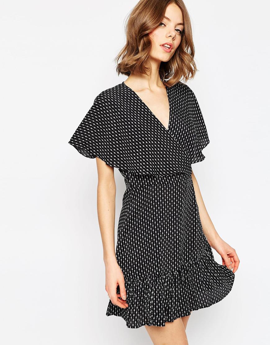 Ditsy Ruffle Tea Dress Multi - style: tea dress; neckline: v-neck; pattern: polka dot; secondary colour: white; predominant colour: black; occasions: evening; length: just above the knee; fit: body skimming; fibres: viscose/rayon - 100%; sleeve length: short sleeve; sleeve style: standard; pattern type: fabric; texture group: jersey - stretchy/drapey; multicoloured: multicoloured; season: s/s 2016; wardrobe: event
