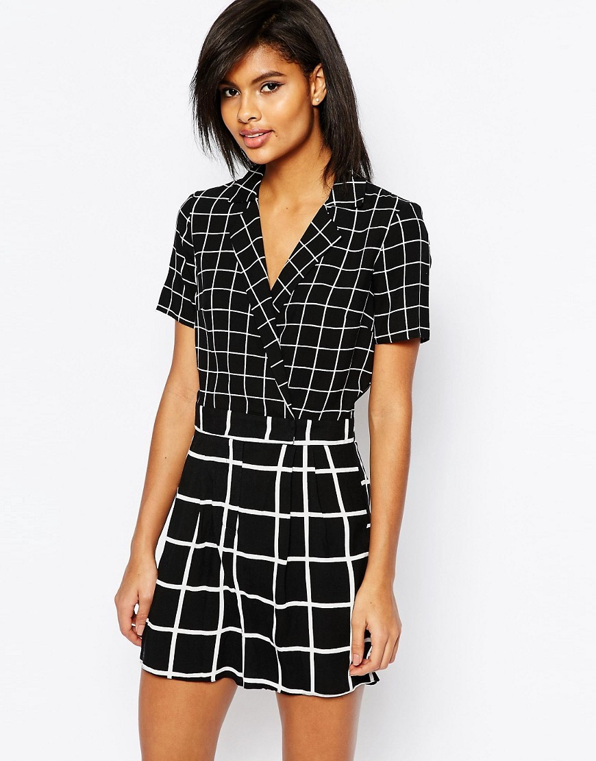 Wrap Playsuit In Mono Geo Print Multi - neckline: shirt collar/peter pan/zip with opening; pattern: checked/gingham; length: short shorts; secondary colour: white; predominant colour: black; occasions: evening; fit: body skimming; fibres: viscose/rayon - 100%; sleeve length: short sleeve; sleeve style: standard; trends: monochrome; texture group: crepes; style: playsuit; pattern type: fabric; multicoloured: multicoloured; season: s/s 2016; wardrobe: event