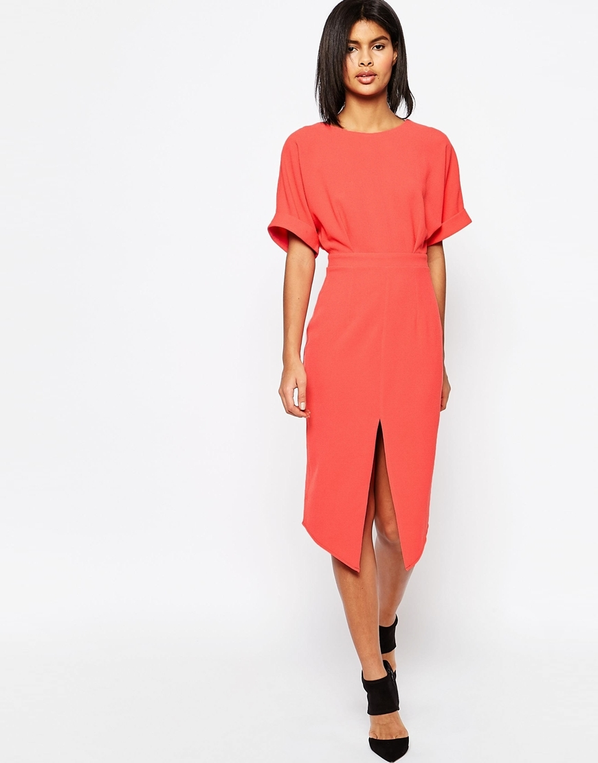 Wiggle Dress With Split Front Coral - style: shift; length: below the knee; fit: tailored/fitted; pattern: plain; predominant colour: coral; fibres: polyester/polyamide - 100%; occasions: occasion, creative work; neckline: crew; hip detail: slits at hip; sleeve length: short sleeve; sleeve style: standard; texture group: crepes; pattern type: fabric; season: s/s 2016; wardrobe: highlight