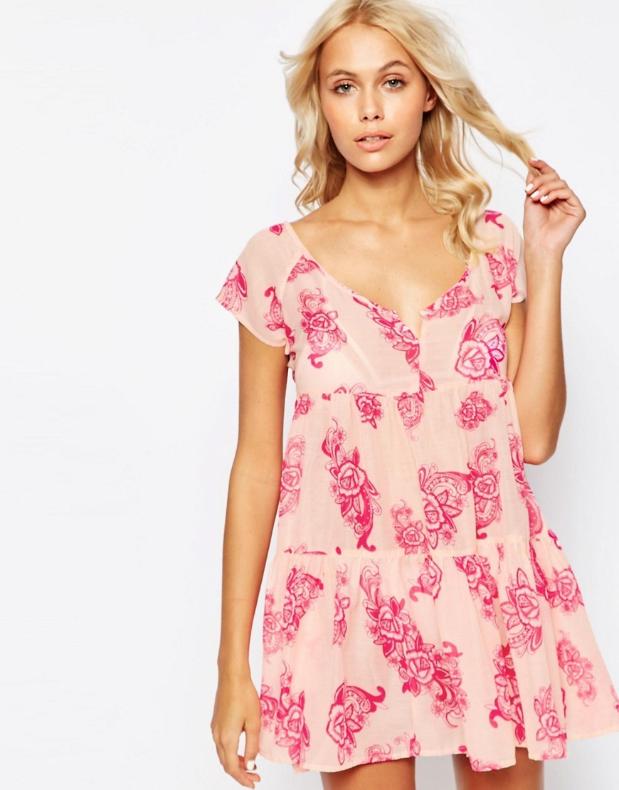Hippy Paisley Print Tiered Smock Beach Dress Hippy Paisley - style: smock; length: mid thigh; neckline: low v-neck; fit: loose; waist detail: drop waist; predominant colour: blush; secondary colour: hot pink; occasions: casual, holiday; fibres: polyester/polyamide - 100%; sleeve length: short sleeve; sleeve style: standard; pattern type: fabric; pattern: florals; texture group: other - light to midweight; multicoloured: multicoloured; season: s/s 2016; wardrobe: highlight