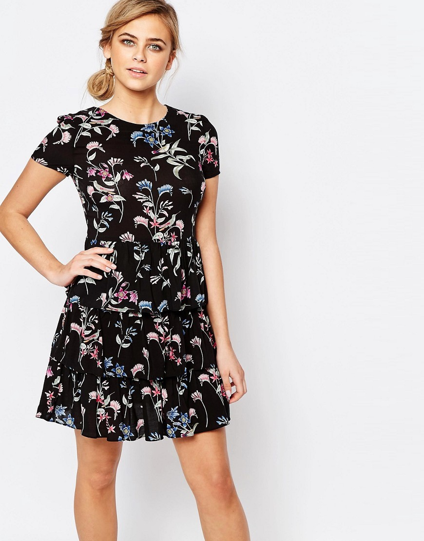 Botanical Tiered Dress Black - secondary colour: pink; predominant colour: black; occasions: evening; length: just above the knee; fit: fitted at waist & bust; style: fit & flare; fibres: viscose/rayon - 100%; neckline: crew; sleeve length: short sleeve; sleeve style: standard; pattern type: fabric; pattern: florals; texture group: jersey - stretchy/drapey; multicoloured: multicoloured; season: s/s 2016; wardrobe: event