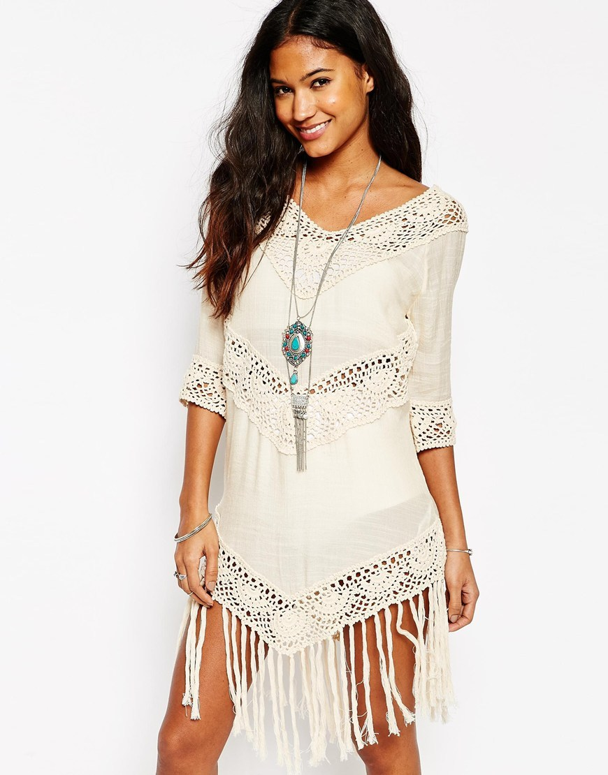 Crochet Tunic Dress With Fringing Nude - style: tunic; length: mini; neckline: low v-neck; pattern: plain; predominant colour: ivory/cream; fit: body skimming; fibres: cotton - 100%; sleeve length: 3/4 length; sleeve style: standard; occasions: holiday; pattern type: fabric; texture group: other - light to midweight; embellishment: lace; season: s/s 2016; wardrobe: holiday; embellishment location: trim, waist
