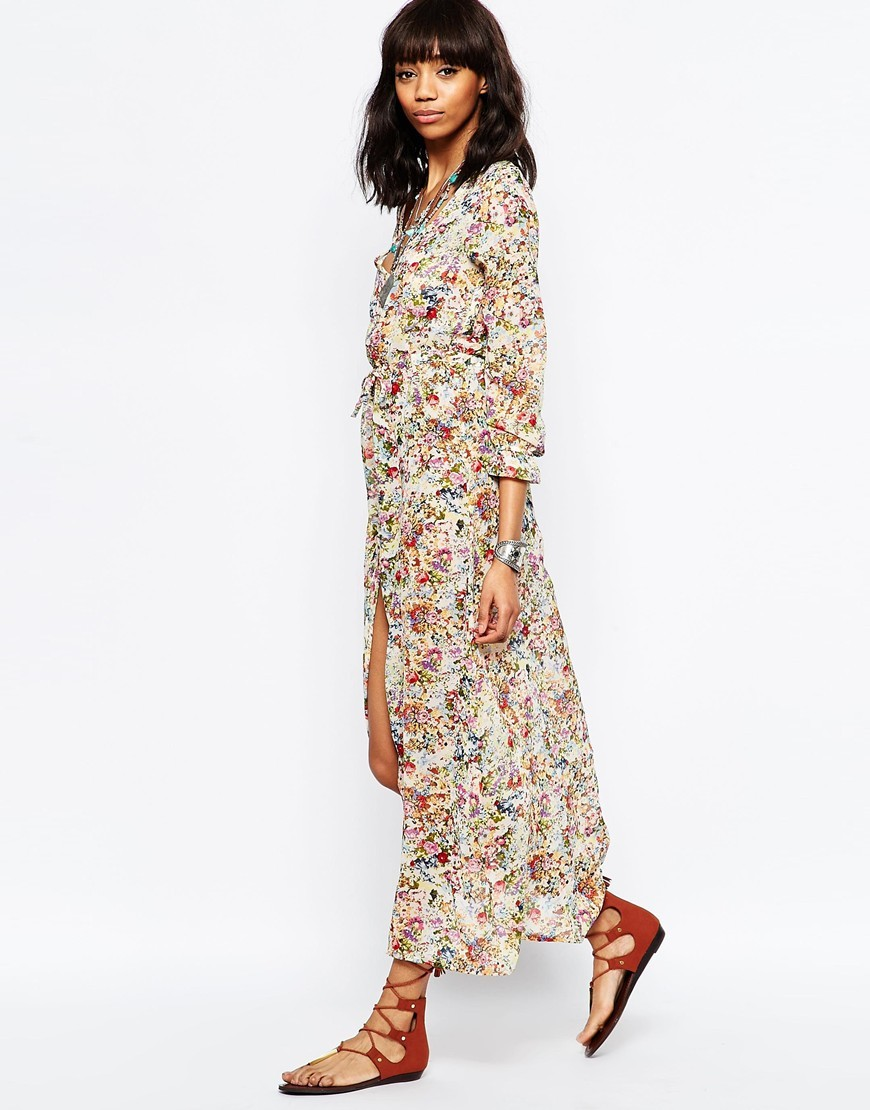 Deep V Floral Maxi Dress Cream - neckline: v-neck; style: maxi dress; length: ankle length; predominant colour: ivory/cream; secondary colour: true red; occasions: casual; fit: body skimming; fibres: cotton - 100%; sleeve length: 3/4 length; sleeve style: standard; texture group: cotton feel fabrics; pattern type: fabric; pattern size: standard; pattern: florals; season: s/s 2016