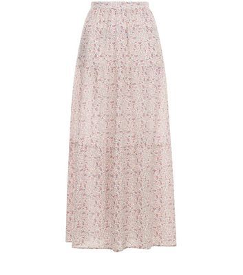 White Ditsy Floral Print Tiered Maxi Skirt - length: ankle length; fit: loose/voluminous; waist: high rise; predominant colour: black; occasions: casual; style: maxi skirt; fibres: polyester/polyamide - 100%; hip detail: soft pleats at hip/draping at hip/flared at hip; waist detail: narrow waistband; texture group: sheer fabrics/chiffon/organza etc.; pattern type: fabric; pattern: florals; pattern size: standard (bottom); season: s/s 2016; wardrobe: highlight