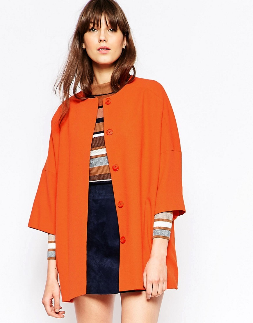 Kimono Coat In Orange Orange - pattern: plain; length: below the bottom; collar: round collar/collarless; fit: loose; style: single breasted; predominant colour: bright orange; occasions: casual, creative work; fibres: polyester/polyamide - stretch; sleeve length: 3/4 length; sleeve style: standard; collar break: high; pattern type: fabric; texture group: other - light to midweight; season: s/s 2016