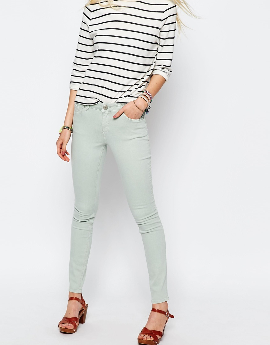 Lisbon Skinny Mid Rise Jeans In Pistachio Pistachio - style: skinny leg; length: standard; pattern: plain; waist: low rise; pocket detail: traditional 5 pocket; predominant colour: pistachio; occasions: casual; fibres: cotton - stretch; texture group: denim; pattern type: fabric; season: s/s 2016; wardrobe: highlight