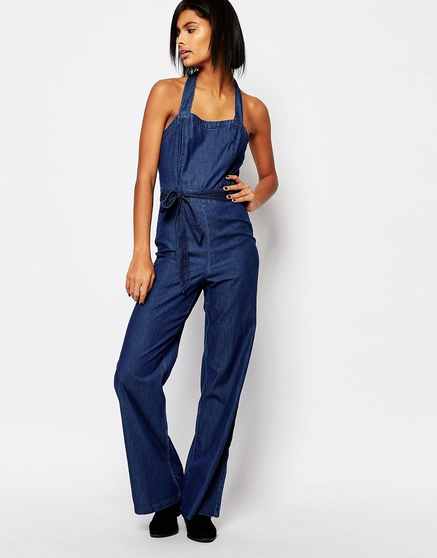 Halterneck Denim Jumpsuit Denim - length: standard; fit: fitted at waist; pattern: plain; sleeve style: sleeveless; neckline: low halter neck; waist detail: belted waist/tie at waist/drawstring; predominant colour: navy; occasions: casual, creative work; fibres: cotton - 100%; sleeve length: sleeveless; texture group: denim; style: jumpsuit; pattern type: fabric; season: s/s 2016; wardrobe: highlight