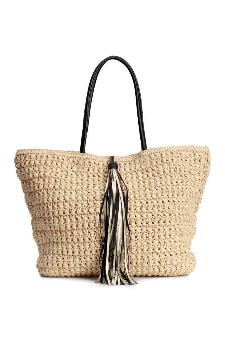 Straw Bag - predominant colour: stone; secondary colour: black; occasions: casual; type of pattern: standard; style: tote; length: handle; size: oversized; material: macrame/raffia/straw; embellishment: tassels; pattern: plain; finish: plain; season: s/s 2016