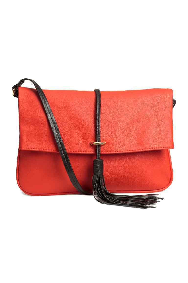 Shoulder Bag With A Tassel - predominant colour: coral; secondary colour: black; type of pattern: light; style: shoulder; length: across body/long; size: standard; material: faux leather; embellishment: tassels; finish: plain; pattern: colourblock; occasions: creative work; season: s/s 2016
