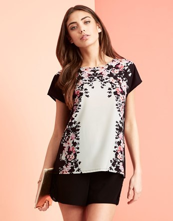 Placement Floral Tee - neckline: round neck; style: t-shirt; predominant colour: blush; secondary colour: black; occasions: casual, creative work; length: standard; fibres: polyester/polyamide - 100%; fit: body skimming; sleeve length: short sleeve; sleeve style: standard; texture group: crepes; pattern type: fabric; pattern size: light/subtle; pattern: florals; season: s/s 2016; wardrobe: highlight