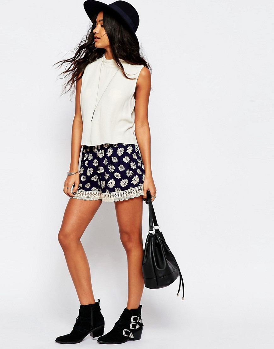 Daisy Print Shorts With Lace Hem Navy - waist: mid/regular rise; secondary colour: white; predominant colour: navy; occasions: casual, creative work; fibres: viscose/rayon - 100%; pattern type: fabric; pattern: patterned/print; texture group: other - light to midweight; embellishment: lace; season: s/s 2016; style: shorts; length: short shorts; wardrobe: highlight