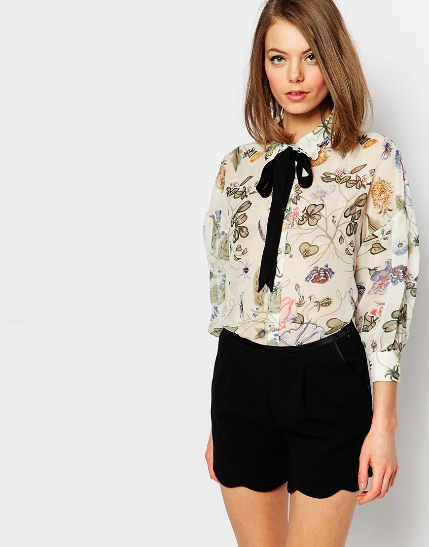 Painted Floral Shirt With Contrats Tie Up Ribbon Multi - neckline: pussy bow; style: blouse; predominant colour: ivory/cream; secondary colour: lilac; occasions: casual; length: standard; fibres: polyester/polyamide - 100%; fit: body skimming; sleeve length: long sleeve; sleeve style: standard; texture group: sheer fabrics/chiffon/organza etc.; pattern type: fabric; pattern: florals; multicoloured: multicoloured; season: s/s 2016; wardrobe: highlight