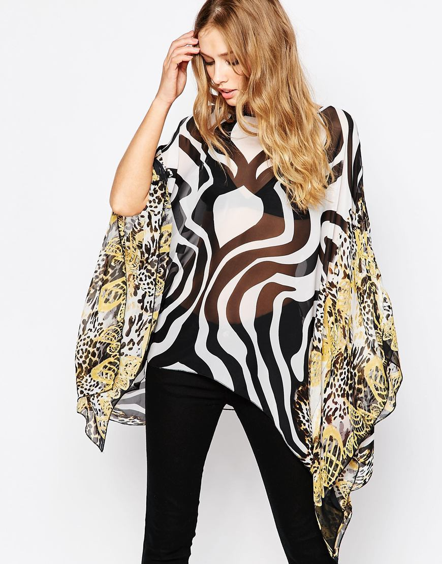 Batwing Top In Zebra Mix Print Multi - sleeve style: angel/waterfall; style: blouse; secondary colour: white; predominant colour: black; occasions: casual; length: standard; fibres: polyester/polyamide - 100%; fit: loose; neckline: crew; sleeve length: long sleeve; texture group: sheer fabrics/chiffon/organza etc.; pattern type: fabric; pattern: patterned/print; multicoloured: multicoloured; season: s/s 2016; wardrobe: highlight