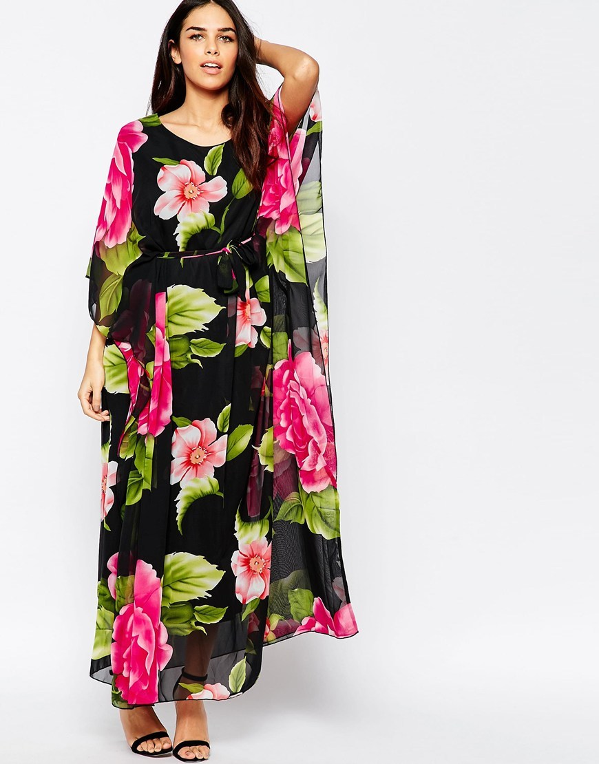 Batwing Maxi Dress In Tropical Floral Print Multi - neckline: round neck; sleeve style: angel/waterfall; fit: loose; style: maxi dress; length: ankle length; waist detail: belted waist/tie at waist/drawstring; secondary colour: hot pink; predominant colour: black; occasions: evening; fibres: polyester/polyamide - 100%; hip detail: subtle/flattering hip detail; sleeve length: long sleeve; texture group: sheer fabrics/chiffon/organza etc.; pattern type: fabric; pattern: florals; multicoloured: multicoloured; season: s/s 2016; wardrobe: event