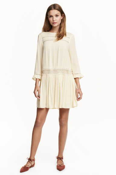 Crinkled Dress - length: mid thigh; neckline: slash/boat neckline; fit: loose; pattern: plain; style: drop waist; predominant colour: ivory/cream; occasions: casual, creative work; fibres: polyester/polyamide - 100%; hip detail: soft pleats at hip/draping at hip/flared at hip; sleeve length: 3/4 length; sleeve style: standard; texture group: crepes; pattern type: fabric; embellishment: lace; season: s/s 2016; wardrobe: highlight
