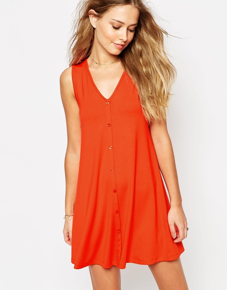 Sleeveless Swing Dress With Button Front Red - style: a-line; length: mini; neckline: v-neck; pattern: plain; sleeve style: sleeveless; predominant colour: true red; occasions: casual; fit: soft a-line; fibres: polyester/polyamide - 100%; sleeve length: sleeveless; texture group: crepes; pattern type: fabric; season: s/s 2016; wardrobe: highlight; embellishment location: bust