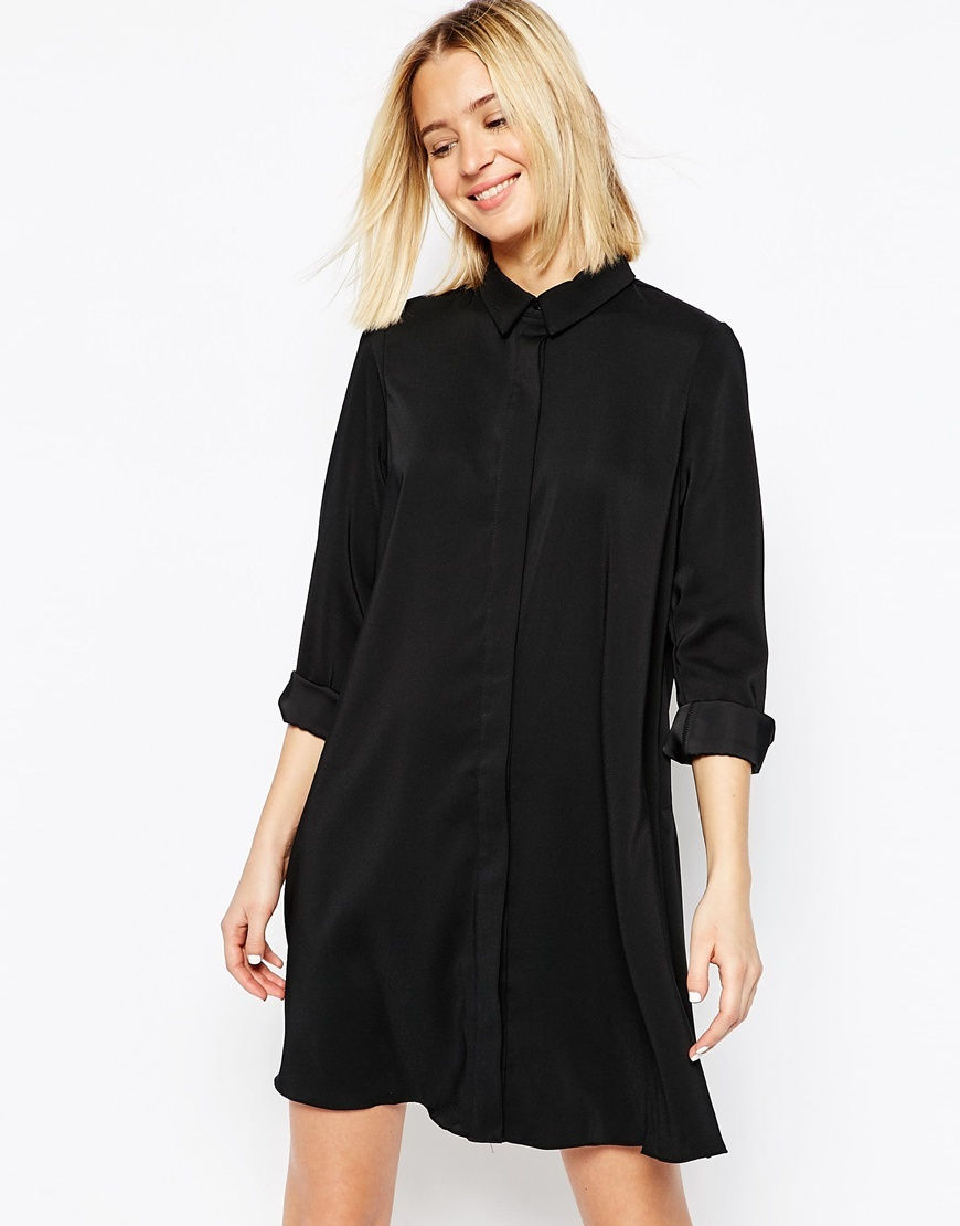 Shirt Dress Black - style: shirt; length: mid thigh; neckline: shirt collar/peter pan/zip with opening; fit: loose; pattern: plain; predominant colour: black; occasions: casual, creative work; fibres: polyester/polyamide - 100%; sleeve length: 3/4 length; sleeve style: standard; texture group: crepes; pattern type: fabric; season: s/s 2016; wardrobe: basic