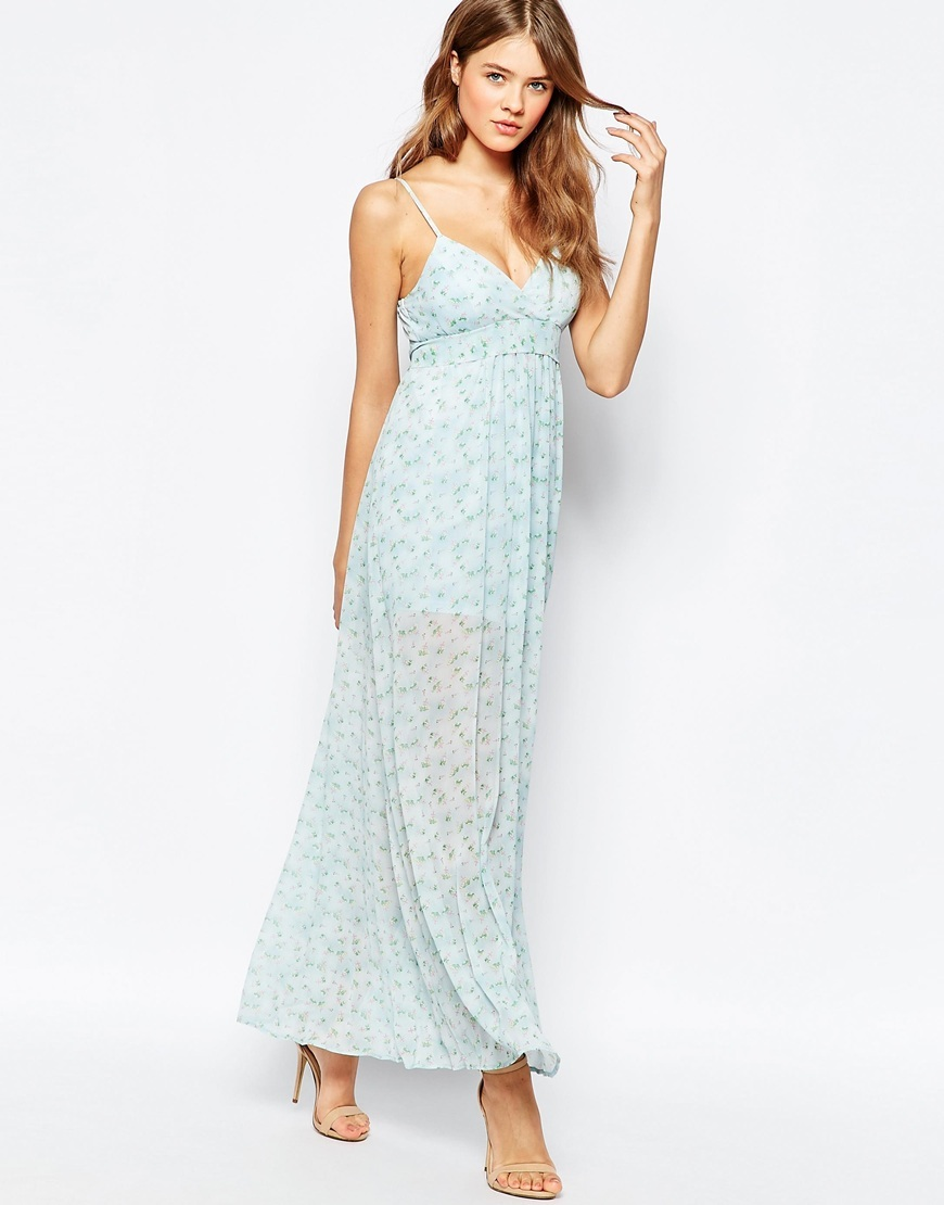Cami Maxi Dress In Ditsy Floral Print Blue - neckline: low v-neck; sleeve style: spaghetti straps; fit: empire; style: maxi dress; predominant colour: pale blue; occasions: casual; length: floor length; fibres: polyester/polyamide - 100%; sleeve length: sleeveless; texture group: sheer fabrics/chiffon/organza etc.; pattern type: fabric; pattern size: light/subtle; pattern: patterned/print; season: s/s 2016; wardrobe: highlight