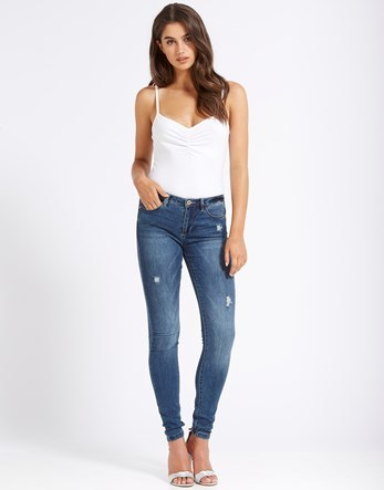 Regular Skinny Jeans - style: skinny leg; length: standard; pattern: plain; waist: high rise; pocket detail: traditional 5 pocket; predominant colour: denim; occasions: casual; fibres: cotton - mix; jeans detail: shading down centre of thigh, rips; texture group: denim; pattern type: fabric; season: s/s 2016; wardrobe: basic
