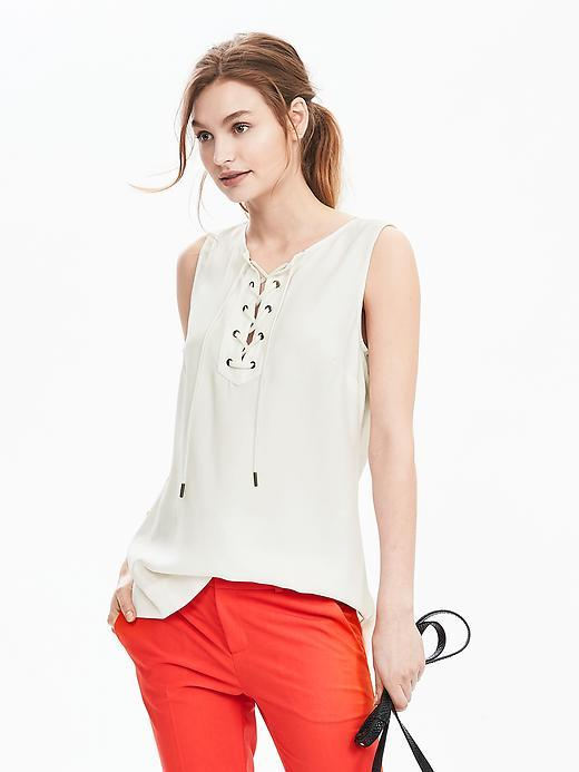 Sleeveless Lace Up Top Cocoon - neckline: v-neck; pattern: plain; sleeve style: sleeveless; style: wrap/faux wrap; predominant colour: ivory/cream; occasions: casual, creative work; length: standard; fibres: viscose/rayon - 100%; fit: body skimming; sleeve length: sleeveless; pattern type: fabric; texture group: other - light to midweight; season: s/s 2016; wardrobe: basic; embellishment location: bust