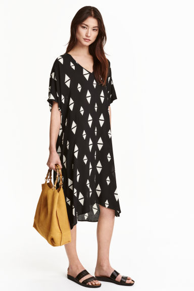 Patterned Viscose Dress - style: smock; length: calf length; neckline: v-neck; fit: loose; secondary colour: white; predominant colour: royal blue; occasions: casual; fibres: viscose/rayon - 100%; sleeve length: half sleeve; sleeve style: standard; pattern type: fabric; pattern: patterned/print; texture group: jersey - stretchy/drapey; multicoloured: multicoloured; season: s/s 2016; wardrobe: highlight