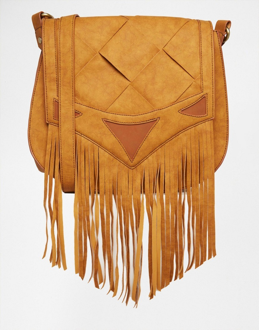 Woven Saddle Bag With Fringing Tan - predominant colour: camel; occasions: casual, creative work; type of pattern: standard; style: saddle; length: across body/long; size: standard; material: faux leather; embellishment: tassels; pattern: plain; finish: plain; season: s/s 2016; wardrobe: basic