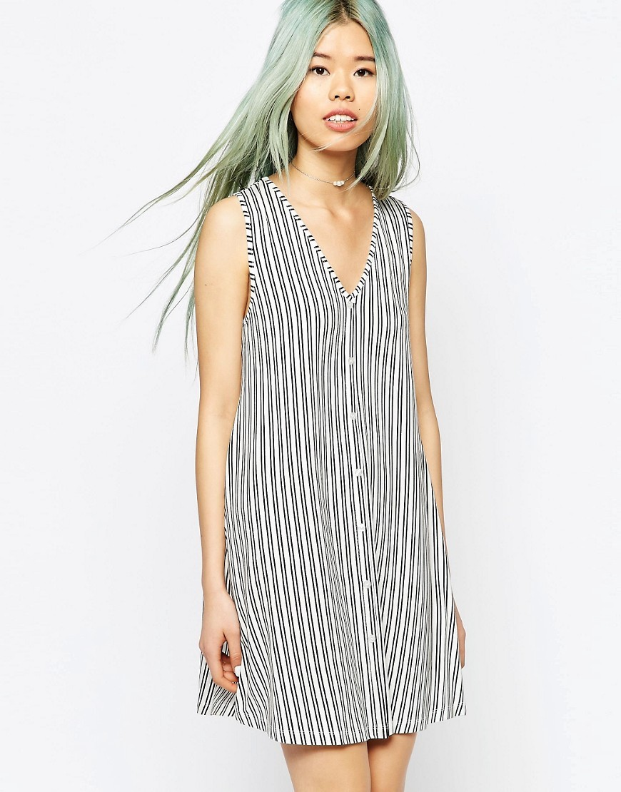 Sleeveless Button Through Swing Dress In Stripe Print White/Black - length: mini; neckline: low v-neck; pattern: vertical stripes; sleeve style: sleeveless; style: vest; predominant colour: white; secondary colour: black; occasions: casual; fit: straight cut; fibres: cotton - mix; sleeve length: sleeveless; trends: monochrome; pattern type: fabric; pattern size: standard; texture group: woven light midweight; season: s/s 2016; wardrobe: highlight; embellishment location: bust
