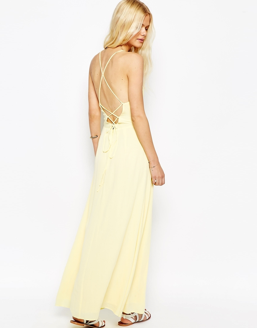 Maxi Dress With Tie Back Yellow - neckline: high square neck; sleeve style: spaghetti straps; pattern: plain; style: maxi dress; length: ankle length; predominant colour: primrose yellow; fit: fitted at waist & bust; fibres: polyester/polyamide - 100%; hip detail: soft pleats at hip/draping at hip/flared at hip; back detail: crossover; sleeve length: sleeveless; texture group: crepes; occasions: holiday; pattern type: fabric; season: s/s 2016