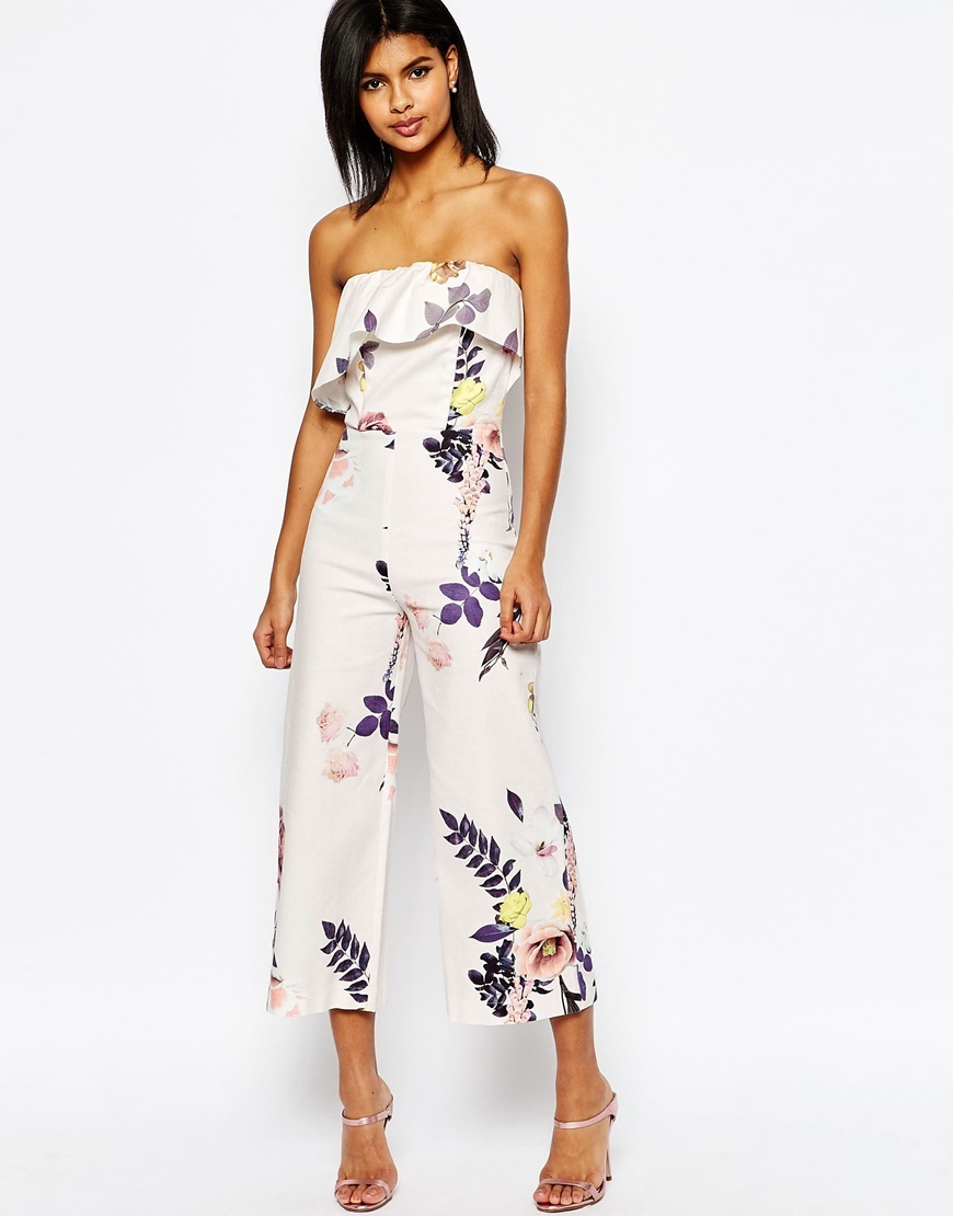 Occasion Floral Jumpsuit With Ruffle Detail Floral - neckline: strapless (straight/sweetheart); fit: fitted at waist; sleeve style: strapless; predominant colour: ivory/cream; secondary colour: aubergine; occasions: evening, occasion; length: calf length; fibres: polyester/polyamide - 100%; sleeve length: sleeveless; style: jumpsuit; bust detail: bulky details at bust; pattern type: fabric; pattern size: standard; pattern: florals; texture group: woven light midweight; multicoloured: multicoloured; season: s/s 2016; wardrobe: event