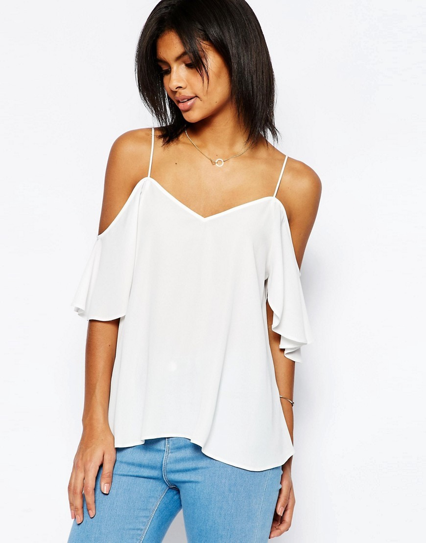Cold Shoulder Cami White - neckline: low v-neck; pattern: plain; predominant colour: white; occasions: casual; length: standard; style: top; fibres: polyester/polyamide - 100%; fit: loose; shoulder detail: cut out shoulder; sleeve length: short sleeve; sleeve style: standard; pattern type: fabric; texture group: jersey - stretchy/drapey; season: s/s 2016; wardrobe: highlight