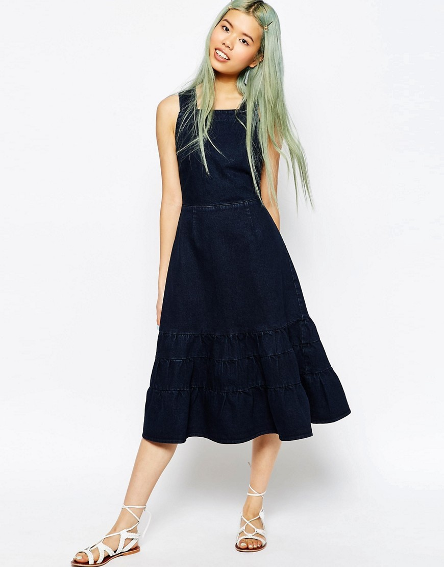 Denim Carmen Midi Dress With Tiered Hem In Dark Blue Light Blue - length: below the knee; pattern: plain; sleeve style: sleeveless; predominant colour: navy; occasions: casual; fit: fitted at waist & bust; style: fit & flare; fibres: cotton - stretch; sleeve length: sleeveless; texture group: denim; neckline: medium square neck; hip detail: ruffles/tiers/tie detail at hip; pattern type: fabric; season: s/s 2016; wardrobe: highlight