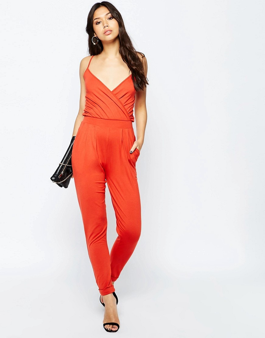 Cami Wrap Front Jersey Jumpsuit With Peg Leg Rust - length: standard; neckline: low v-neck; sleeve style: spaghetti straps; fit: fitted at waist; pattern: plain; predominant colour: bright orange; occasions: evening; fibres: viscose/rayon - stretch; sleeve length: sleeveless; style: jumpsuit; pattern type: fabric; texture group: jersey - stretchy/drapey; season: s/s 2016; wardrobe: event