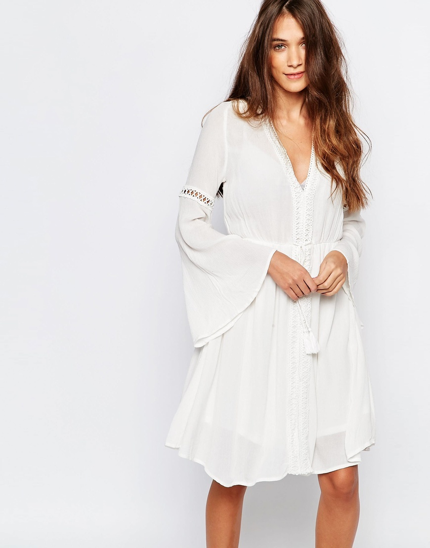 Long Sleeve Dress With Open Back Ecru - style: faux wrap/wrap; neckline: low v-neck; pattern: plain; back detail: back revealing; sleeve style: trumpet; waist detail: belted waist/tie at waist/drawstring; predominant colour: ivory/cream; occasions: casual; length: just above the knee; fit: body skimming; fibres: polyester/polyamide - 100%; sleeve length: long sleeve; texture group: sheer fabrics/chiffon/organza etc.; pattern type: fabric; season: s/s 2016; wardrobe: basic
