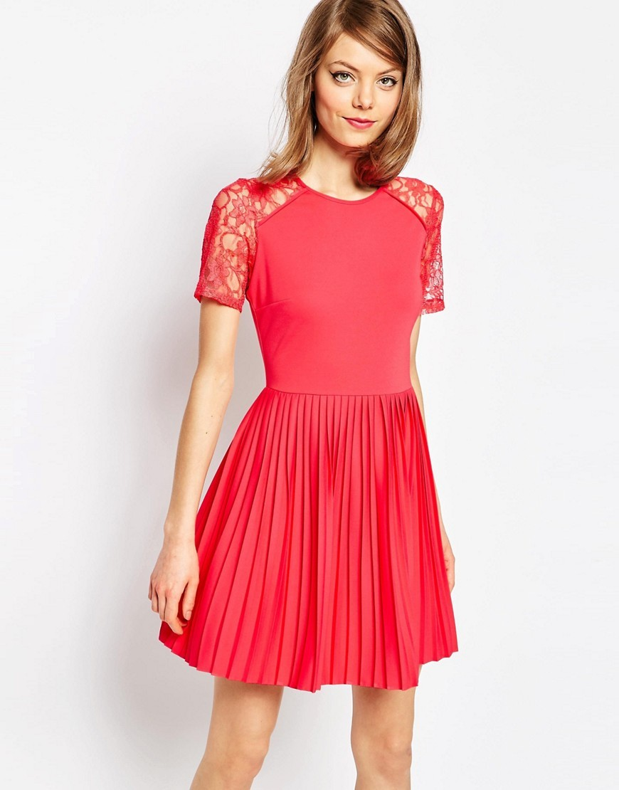 Pleat And Textured Mini Dress With Lace Inserts Coral - length: mid thigh; neckline: round neck; pattern: plain; predominant colour: coral; occasions: evening, occasion; fit: fitted at waist & bust; style: fit & flare; fibres: polyester/polyamide - 100%; hip detail: adds bulk at the hips; sleeve length: short sleeve; sleeve style: standard; texture group: crepes; pattern type: fabric; embellishment: lace; shoulder detail: sheer at shoulder; season: s/s 2016; wardrobe: event; embellishment location: shoulder