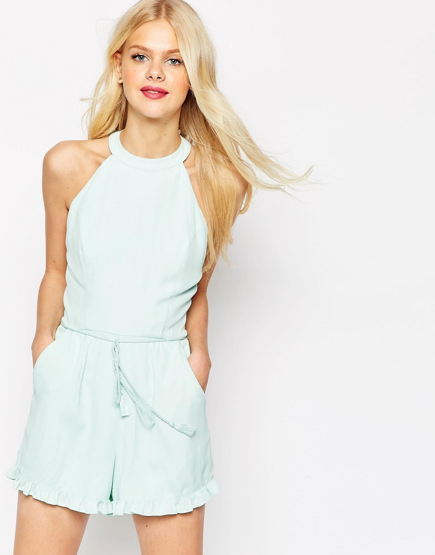 High Neck Ruffle Hem Playsuit With Rope Tie Mint - fit: fitted at waist; pattern: plain; sleeve style: sleeveless; waist detail: belted waist/tie at waist/drawstring; length: short shorts; predominant colour: pistachio; occasions: evening, holiday; fibres: polyester/polyamide - 100%; sleeve length: sleeveless; style: playsuit; pattern type: fabric; texture group: other - light to midweight; season: s/s 2016; neckline: high halter neck
