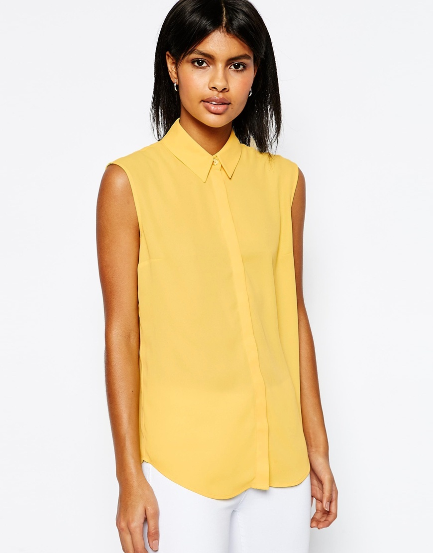 Sleeveless Blouse Lemon - neckline: shirt collar/peter pan/zip with opening; pattern: plain; sleeve style: sleeveless; length: below the bottom; style: blouse; predominant colour: yellow; occasions: casual, creative work; fibres: viscose/rayon - 100%; fit: body skimming; sleeve length: sleeveless; pattern type: fabric; texture group: other - light to midweight; season: s/s 2016; wardrobe: highlight