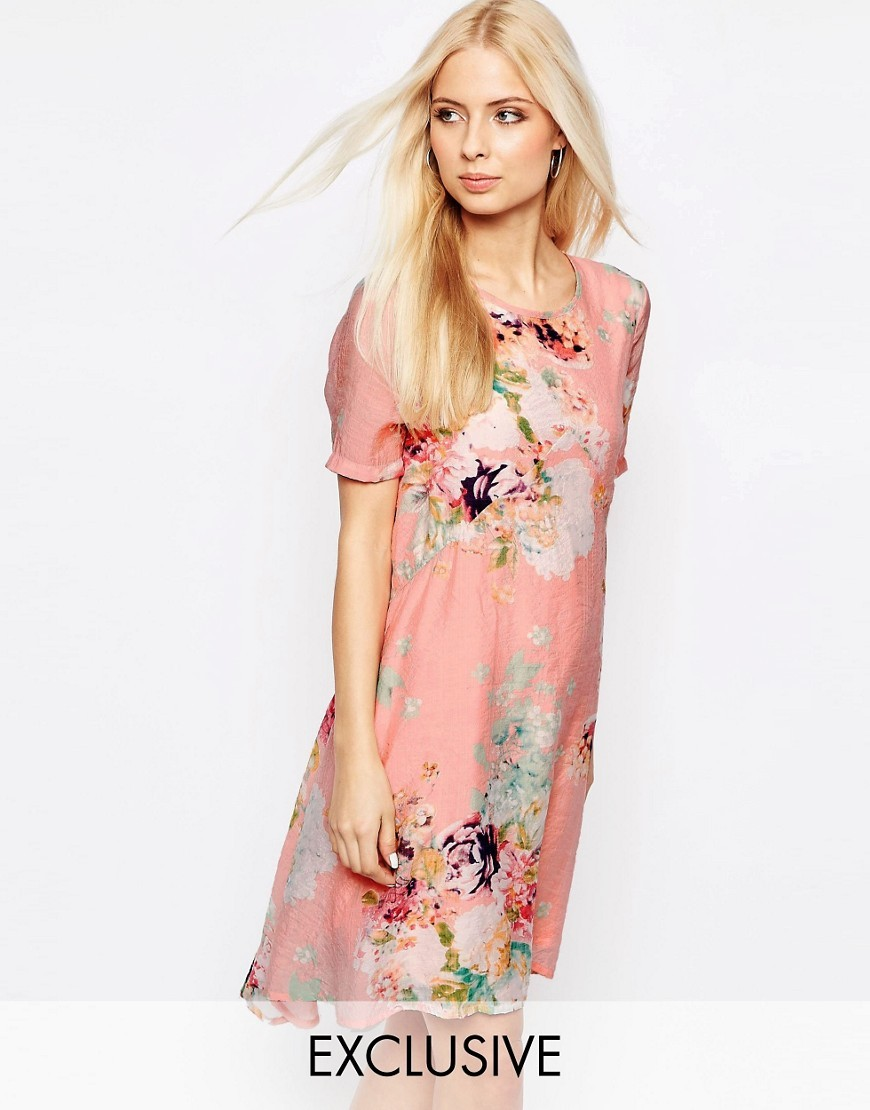 Floral Drop Hem Dress Floral - style: shift; secondary colour: ivory/cream; predominant colour: pink; occasions: evening; length: just above the knee; fit: body skimming; fibres: polyester/polyamide - 100%; neckline: crew; sleeve length: short sleeve; sleeve style: standard; pattern type: fabric; pattern: florals; texture group: other - light to midweight; multicoloured: multicoloured; season: s/s 2016; wardrobe: event
