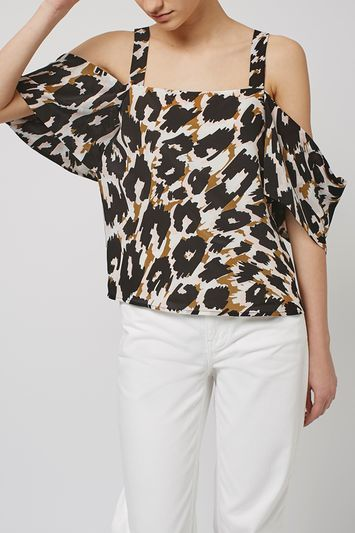 Leopard Off The Shoulder Top By Boutique - neckline: off the shoulder; predominant colour: white; secondary colour: black; occasions: evening; length: standard; style: top; fibres: silk - 100%; fit: loose; sleeve length: short sleeve; sleeve style: standard; pattern type: fabric; pattern: animal print; texture group: other - light to midweight; multicoloured: multicoloured; trends: glossy girl; season: s/s 2016