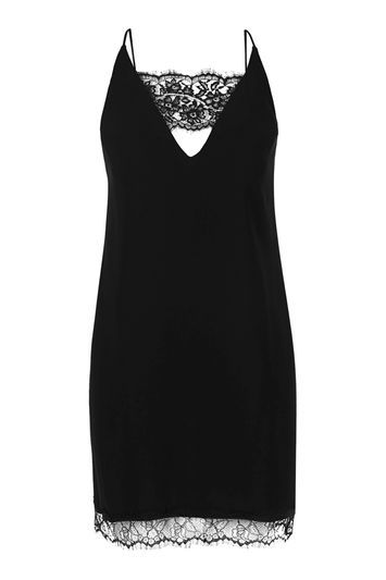 Lace Trim Slip Dress - length: mini; neckline: low v-neck; sleeve style: spaghetti straps; predominant colour: black; occasions: evening; fit: body skimming; style: slip dress; fibres: polyester/polyamide - 100%; back detail: crossover; sleeve length: sleeveless; pattern type: fabric; pattern size: standard; pattern: patterned/print; texture group: other - light to midweight; embellishment: lace; trends: glossy girl, rebel girl; season: s/s 2016; wardrobe: event; embellishment location: bust